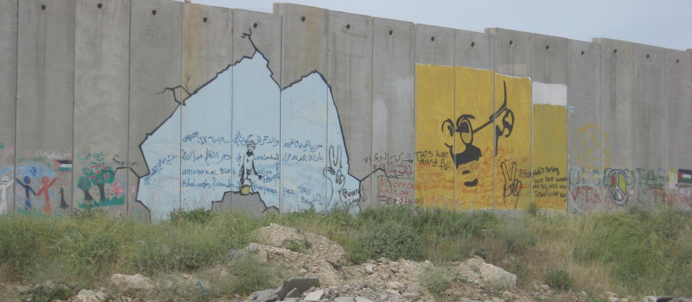 Graffiti paintings on the Israeli West Bank barrier by Banksy near Qalandia - July 2005 - Public Domain